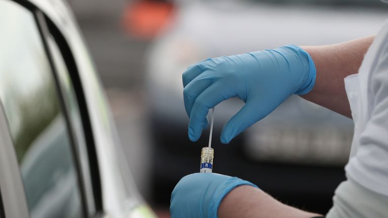 A test sample is held at a Covid-19 testing centre at Glasgow Airport, as the UK continues in lockdown to help curb the spread of the coronavirus.