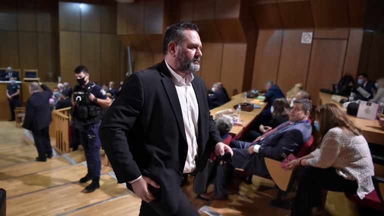 Independent European parliamentarian MP Ioannis Lagos, a top Golden Dawn organiser who defected from the party last year, 2019, after winning a European parliament seat, leaves the courtroom in Athens on october 12, 2020. - The Greek courts on October 12, 2020, rejected calls for leniency for the leaders of notorious Greek neo-Nazi party Golden Dawn party, paving the way for sentences of up to 15 years after a five-year trial. The court refused lawyers' requests to consider mitigating factors when sentencing the party founder and long-term leader and six other former party lawmakers. (Photo by LOUISA GOULIAMAKI / AFP) (Photo by LOUISA GOULIAMAKI/AFP via Getty Images)