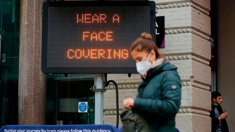 """A pedestrian walks past a sign displaying a message to wear a face covering, outside Charing Cross station in central London on October 14, 2020, as the number of cases continue to rise during the novel coronavirus COVID-19 pandemic - Prime Minister Boris Johnson on Wednesday said a new UK-wide lockdown would be a """"disaster"""" but refused to rule it out as demands grew for a temporary shutdown to stop the spread of coronavirus. (Photo by Tolga AKMEN / AFP) (Photo by TOLGA AKMEN/AFP via Getty Im<a href=http://news.sky.com/story/coronavirus-toughest-restrictions-considered-for-parts-of-yorkshire-and-the-north-east-12108464>Read More – Source</a></p> [contf] [contfnew]         <img src="""