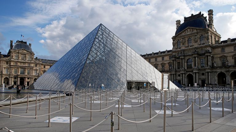 PARIS, FRANCE - OCTOBER 14: The empty courtyard of the Louvre museum and the pyramid of Louvre are seen without tourists on October 14, 2020 in Paris, France. Deserted since the reopening of its doors on Monday, July 6, the most visited museum in the world is idling due to the absence of foreign tourists due to the epidemic of Coronavirus (Covid 19). French President Emmanuel Macron announced on television this evening a curfew for Ile-de-France and eight metropolises between 9 p.m. and 6 a.m. on Saturday  to tackle a second wave of the coronavirus outbreak  across France. (Photo by Chesnot/Getty Images)