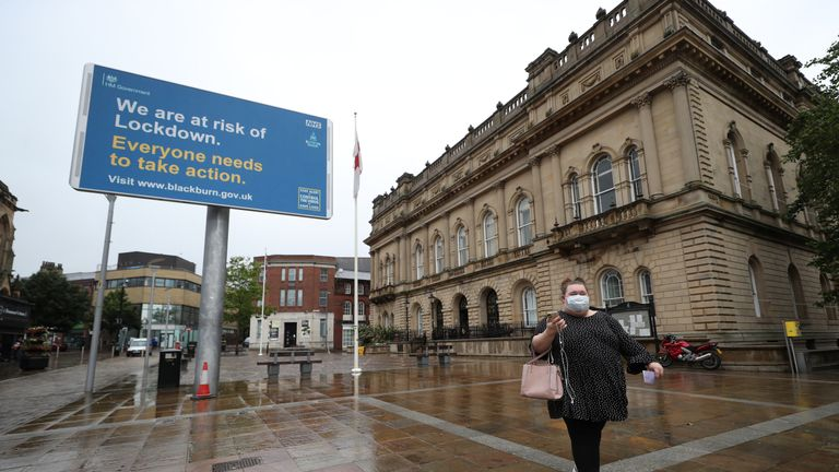 "An advisory from the UK Government and Blackburn with Darwen Borough Council on a billboard outside Blackburn Town Hall, as the town is facing a ""rising tide"" of coronavirus cases, centered on its large Asian community."