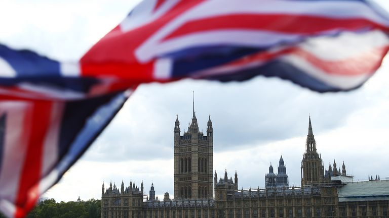 LONDON, ENGLAND - OCTOBER 03: A Union flag blows in the wind near the Houses of Parliament on October 3, 2019 in London, England. (Photo by Hollie Adams/Getty Images)