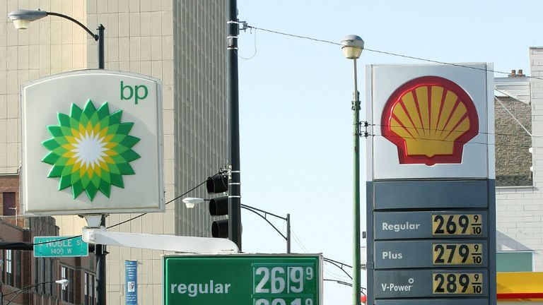 CHICAGO - JANUARY 12: A motorist in her SUV departs a BP Amoco gas station adjacent a Shell Oil gas station January 12, 2006 in Chicago, Illinois. Oil prices have risen on concerns of Iran's reported possible nuclear development. (Photo by Tim Boyle/Getty Images)
