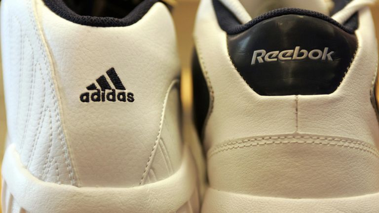 OLDENBURG, Germany:  Sports shoes by Adidas (L) and Reebok are seen in a shop in Oldenburg 03 August 2005. Adidas-Salomon, the German maker of sportswear and equipment, launched a 3.1-billion-euro (3.8-billion-dollar) bid 03 August 2005 to buy US rival Reebok in an attempt to close the distance on its arch-enemy and world leader, Nike. AFP PHOTO DDP/DAVID HECKER     GERMANY OUT  (Photo credit should read DAVID HECKER/DDP/AFP via Getty Images)