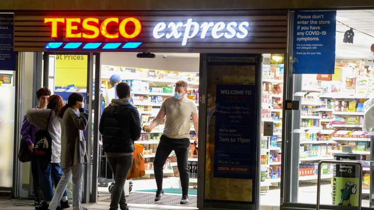 "BRISTOL, ENGLAND - OCTOBER 12: People are seen at Tesco Express on October 12, 2020 in Bristol, England. Despite the coronavirus infection rate in the city jumping from 44.2 new cases per 100,000 to 95.4 in the week ending Thursday, October 8, Bristol has been graded as medium or ""Tier 1"" in the government's new three-tier Covid-19 alert system. Tier 1 means that the rule of six should be observed and that there is a 10 p.m. curfew on pubs and restaurants.  (Photo by Finnbarr Webster/Getty Images)"