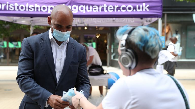 Mayor of Bristol Marvin Rees (left) joins other members of Bristol City Council as they hand out 80,000 face masks in Bristol city centre as face coverings become mandatory in shops and supermarkets in England.
