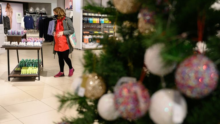 """LONDON, ENGLAND - OCTOBER 20: A customer browses some of the festive items in the Christmas gift and decoration section in the branch of retailer Marks and Spencer at Westfield White City on October 20, 2020 in London, England. The high street store has announced that searches for Christmas-related items have tripled on previous years. The British Retail Consortium (BRC) has launched a new """"Shop early, Start wrapping, Enjoy Christmas"""" national campaign, encouraging British consumers to start their festive shopping early. The aim is to both spread the amount of footfall in stores to aid social distancing, and to ensure that retail stores survive the Christmas period, despite COVID-19 preventative measures. (Photo by Leon Neal/Getty Images)"""