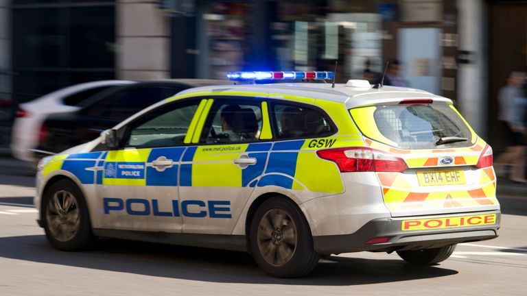 A Metroplitan Police patrol car driving through London, 10th September 2015. (Photo by Kypros/Getty Images)