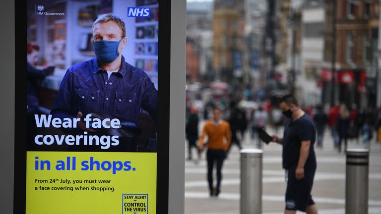 A sign calling for the wearing of face-masks in shops is displayed  in the city centre of Leeds, on July 23, 2020, as lockdown restrictions continue to be eased during the novel coronavirus COVID-19 pandemic. - The wearing of facemasks in shops in England will be compulsory from Friday, but full guidance is yet to be published. (Photo by Oli SCARFF / AFP) (Photo by OLI SCARFF/AFP via Getty Images)