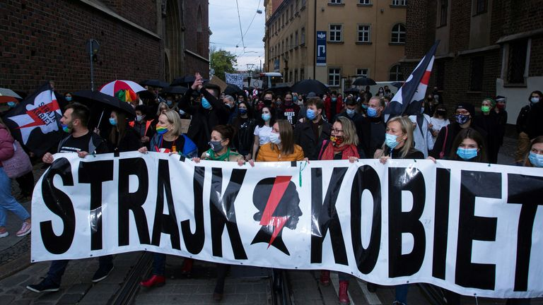 """Demonstrators carry a banner reading """"Women's Strike"""" during a protest against imposing further restrictions on abortion law, in Wroclaw, Poland October 23, 2020. Krzysztof Cwik/Agencja Gazeta/via REUTERS ATTENTION EDITORS - THIS IMAGE WAS PROVIDED BY A THIRD PARTY. POLAND OUT. NO COMMERCIAL OR EDITORIAL SALES IN POLAND."""
