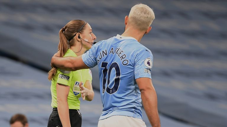 MANCHESTER, ENGLAND - OCTOBER 17: Assistant referee Sian Massey-Ellis and Sergio Aguero of Manchester City during the Premier League match between Manchester City and Arsenal at Etihad Stadium on October 17, 2020 in Manchester, England. Sporting stadiums around the UK remain under strict restrictions due to the Coronavirus Pandemic as Government social distancing laws prohibit fans inside venues resulting in games being played behind closed doors. (Photo by Michael Regan/Getty Images)