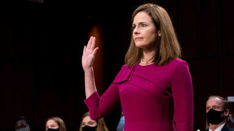 WASHINGTON, DC - OCTOBER 12: Supreme Court Justice nominee Judge Amy Coney Barrett is sworn in during the Senate Judiciary Committee confirmation hearing for Supreme Court Justice in the Hart Senate Office Building on October 12, 2020 in Washington, DC. With less than a month until the presidential election, President Donald Trump tapped Amy Coney Barrett to be his third Supreme Court nominee in just four years. If confirmed, Barrett would replace the late Associate Justice Ruth Bader Ginsburg.