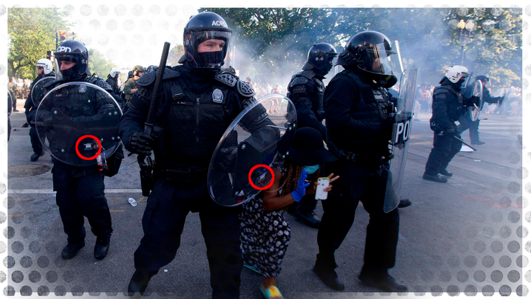 A police officer in Washington DC  carries a UK-made shield during George Floyd protests