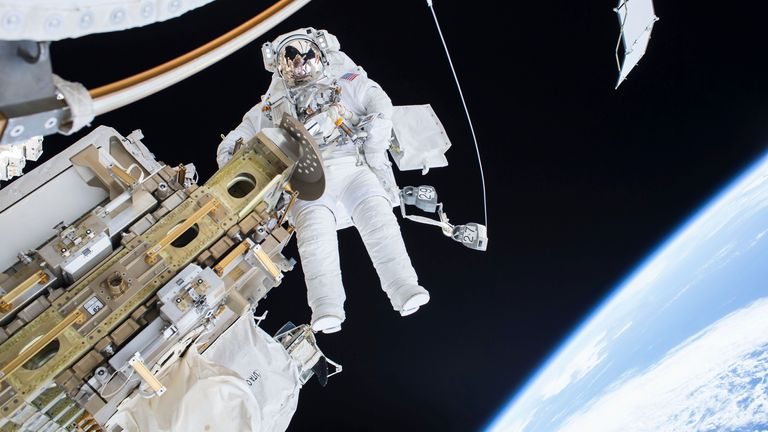 Astronaut Tim Kopra performs a spacewalk outside the International Space Station