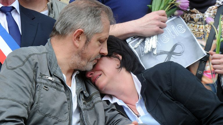 The parents of Aurelie Chatelain seen during a memorial to their daughter in 2015