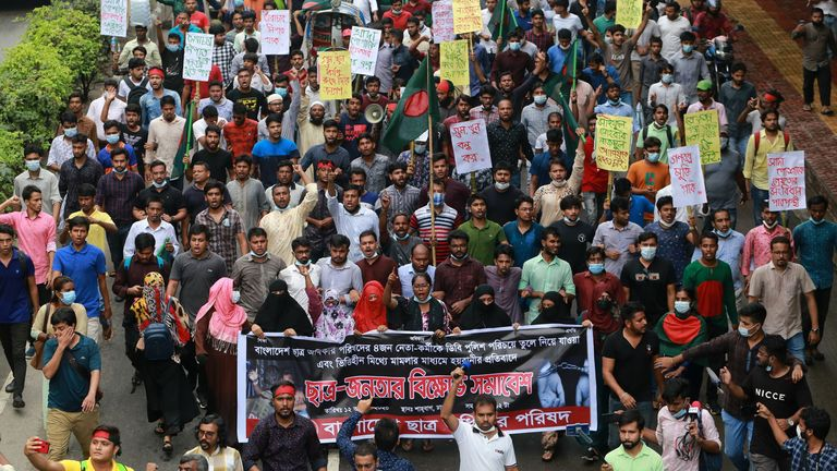 Students take part in a protest march against the arrest of four student leaders over the weekend in Dhaka