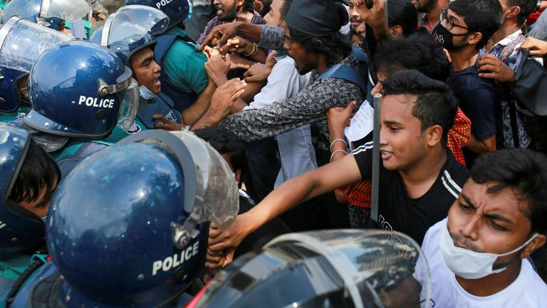 Protesters clash with police during a rally against an alleged gang-rape of a woman in the southern district of Noakhali