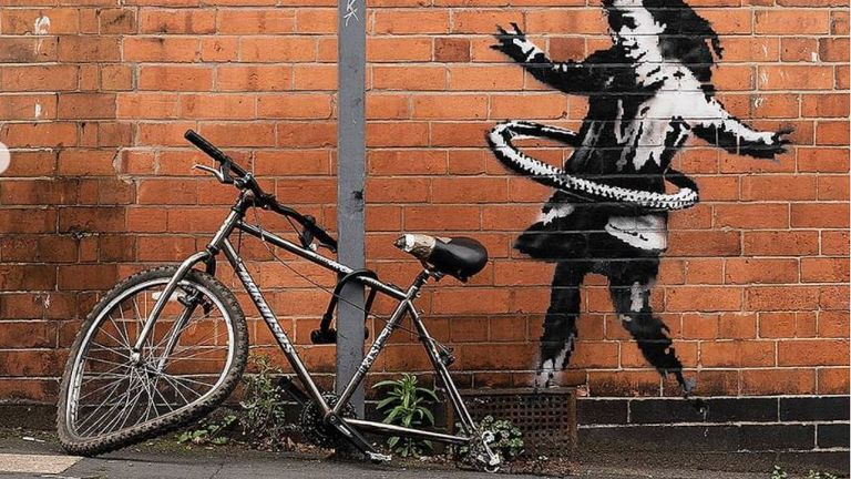 Banksy has posted this image of a girl hula-hooping with a bike tyre on Instagram. Pic: @banksy
