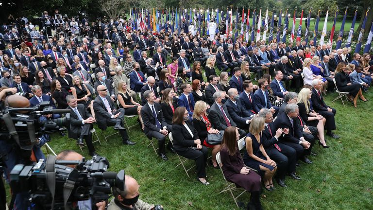 WASHINGTON, DC - SEPTEMBER 26: Guests watch as U.S. President Donald Trump introduces 7th U.S. Circuit Court Judge Amy Coney Barrett as his nominee to the Supreme Court in the Rose Garden at the White House September 26, 2020 in Washington, DC.