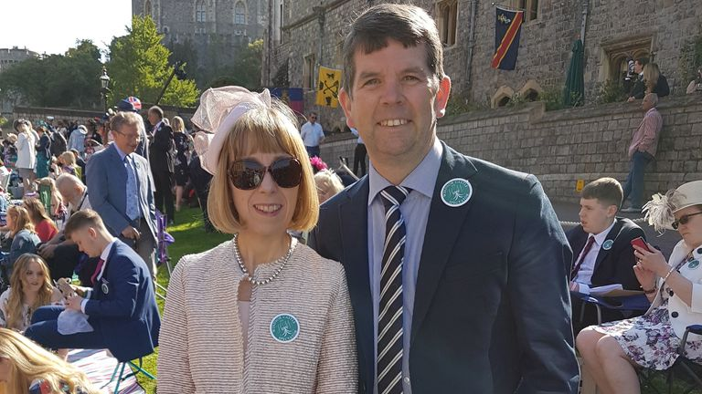 EMBARGOED TO 2230 FRIDAY OCTOBER 09 Undated handout photo of Adrian Petticrew with his partner Sharon Sherrard in the grounds of Windsor Castle for the wedding of Prince Harry and Meghan Markle in 2018. Mr Petticrew, a volunteer with St John Ambulance, has been awarded an OBE for services to St John Ambulance (Northern Ireland) during the Covid-19 response in the Queen's Birthday Honours list.