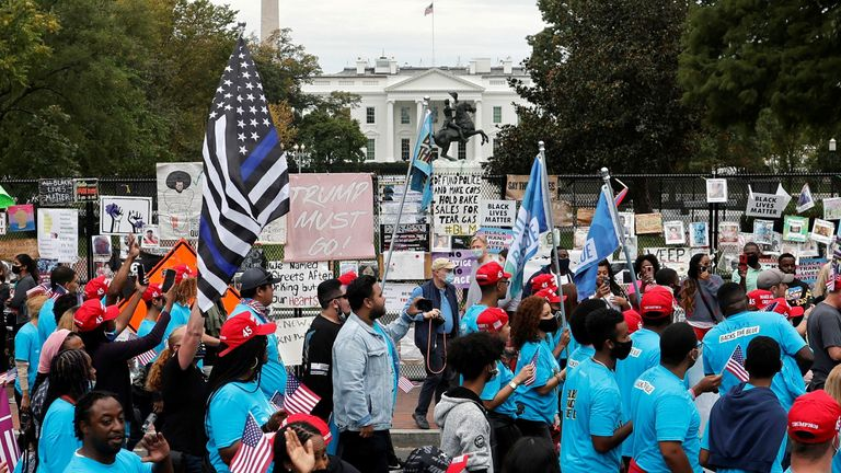 Blexit supporters walk past the White House after leaving the South Lawn