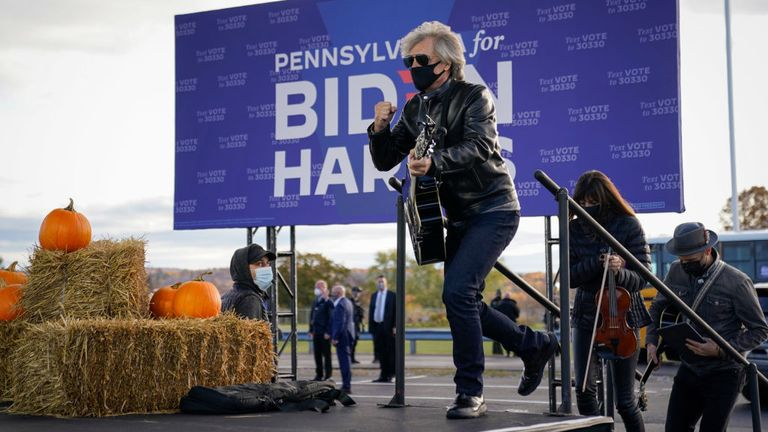Jon Bon Jovi takes the stage to perform during a a drive-in campaign rally for Democratic presidential nominee Joe Biden at Dallas High School on October 24, 2020 in Dallas, Pennsylvania