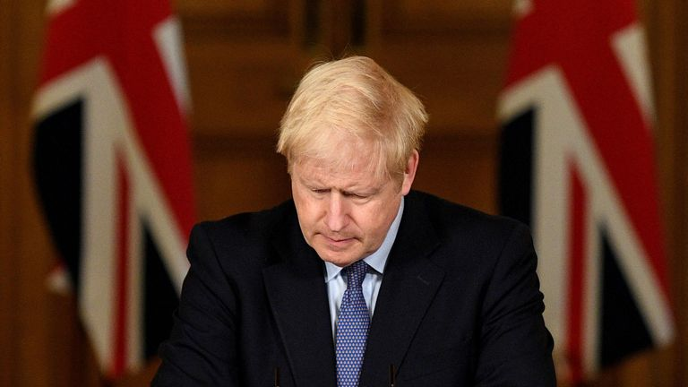Britain's Prime Minister Boris Johnson reacts during a virtual press conference inside 10 Downing Street in central London on October 20, 2020. - British Prime Minister Boris Johnson said on Tuesday he will impose tougher coronavirus restrictions on the English city of Manchester
