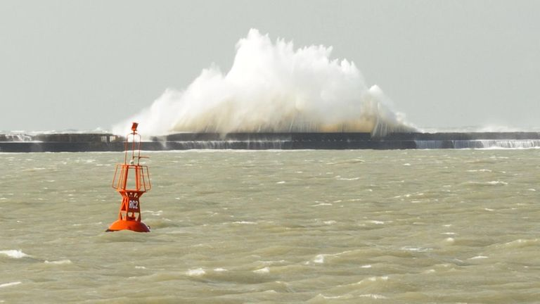 The waves pound into the sea wall in Boulogne-sur-Mer
