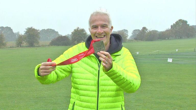 Sky News correspondent Enda Brady holds up his medal from last year's London Marathon