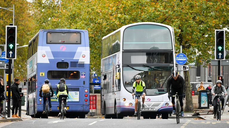 Cyclists and buses share the road on Broad Quay in Bristol City centre, as Bristol could become the UK's first city to introduce a ban on diesel vehicles