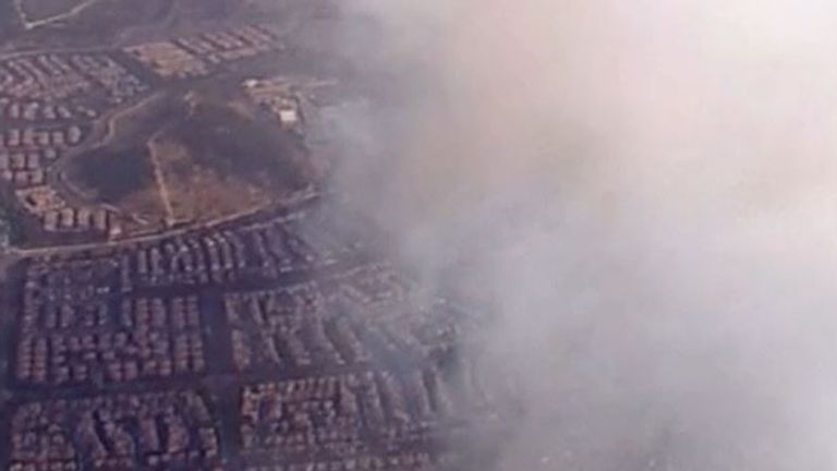 Orange County fires send smoke over houses