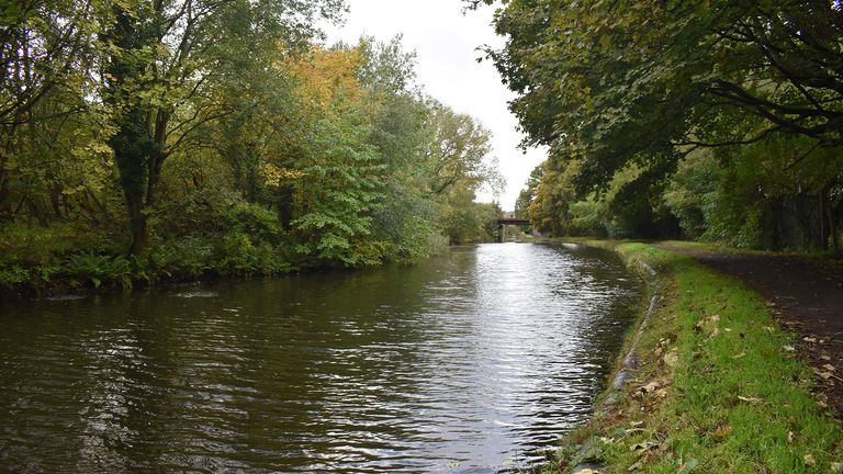 A view of a stretch of canal near Mission Drive in Tipton, West Midlands, which Nathan Maynard-Ellis and David Leesley are alleged to have walked along carrying the dismembered remains of Julia Rawson. Both men deny murder at a trial at Coventry Crown Court.