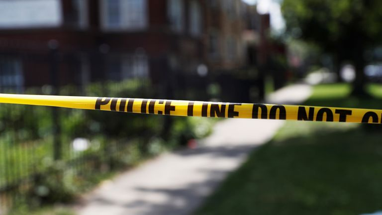 Chicago police crime scene tape is posted at the scene of a gun shooting on the South Side of Chicago July 2020