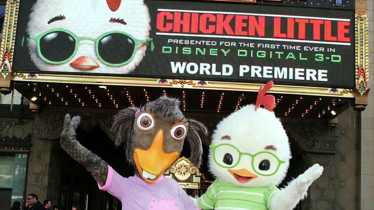 """LOS ANGELES - OCTOBER 30:  Abby Mallard (L) and Chicken Little pose at the premiere of Disney's """"Chicken Little"""" at the El Capitan Theater on October 30, 2005 in Los Angeles, California. (Photo by Kevin Winter/Getty Images) *** Local Caption *** Abby Mallard;Chicken Little"""