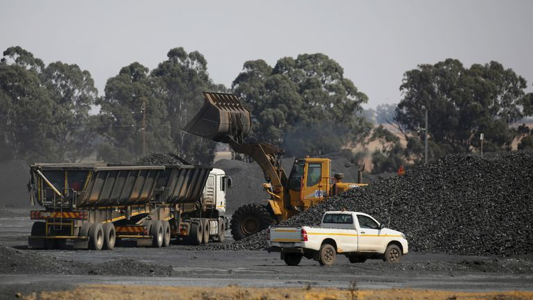 Coal is loaded onto a truck at the Woestalleen colliery near Middleburg