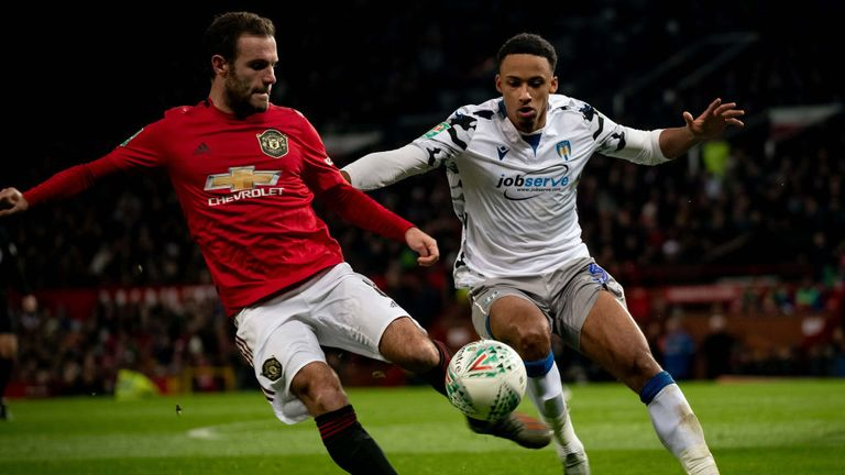 A Colchester United player, right, is seen making a challenge on a Manchester United player in December last year