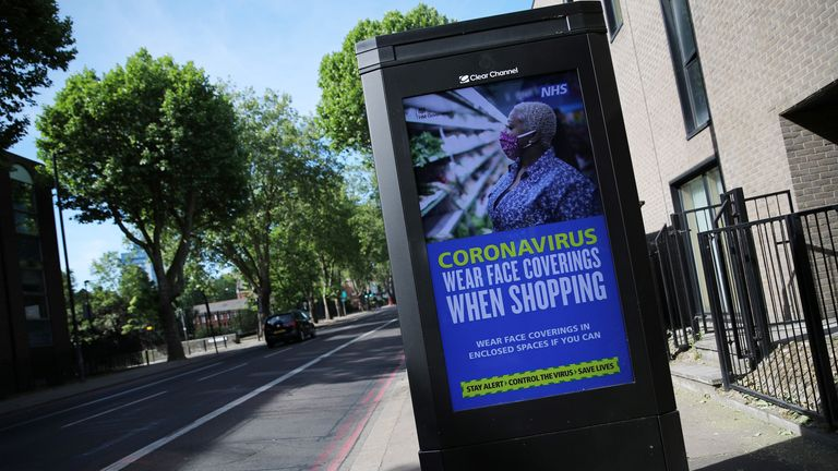 A government and NHS advert is seen on a billboard in London