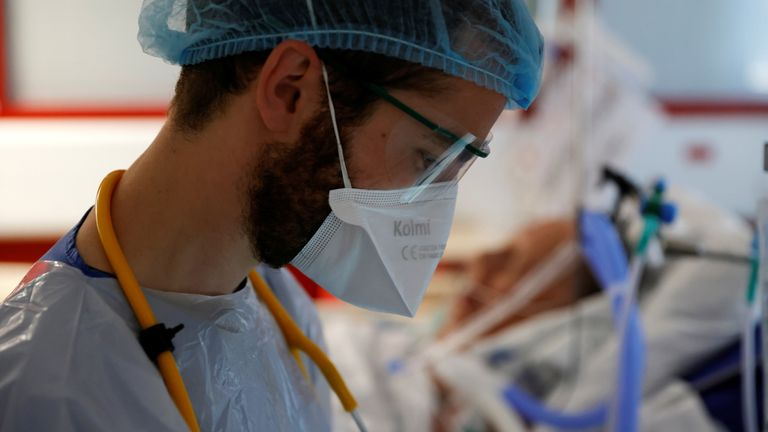 A doctor, wearing a protective mask and a protective suit, works in the Intensive Care Unit (ICU) where patients suffering from the coronavirus disease (COVID-19) are treated at the Bethune-Beuvry hospital in Beuvry, France