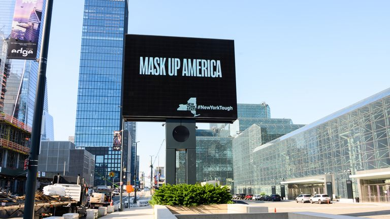 A billboard encourages people to wear a face mask in New York City