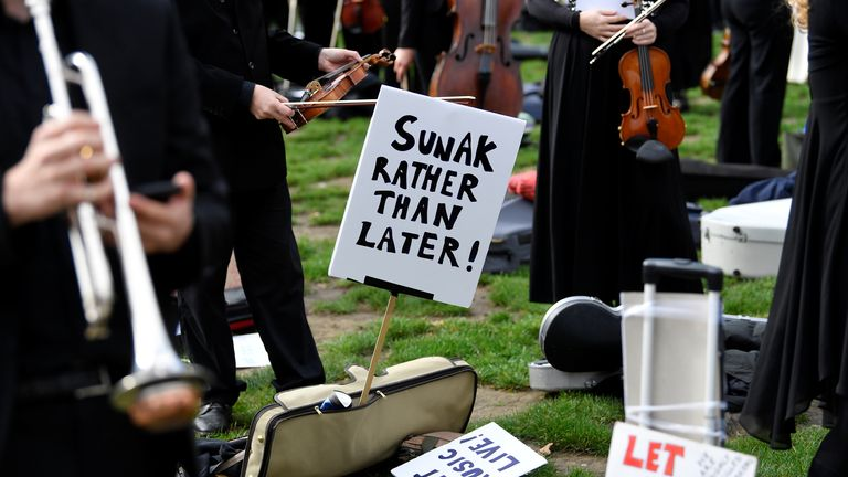 Musicians perform near the houses of Parliament during a protest highlighting their inability to perform live or work during the coronavirus disease (COVID-19) pandemic