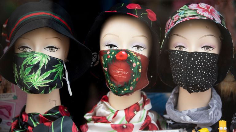 "BRIDGEND, WALES - OCTOBER 28: A close-up of mannequins wearing face masks in shop window on October 28, 2020 in Bridgend, Wales. Wales entered a national lockdown on Friday evening which will remain in place until November 9. People have been told to stay at home and pubs, restaurants, hotels and non-essential shops must shut. Primary schools will reopen after the half-term break, but only Years 7 and 8 in secondary schools can return at that time under new ""firebreak"" rules. Gatherings indoors"