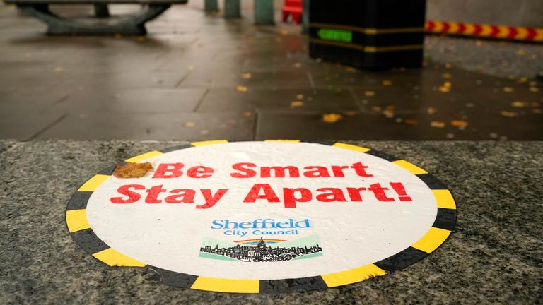 A Covid-19 awareness sign greets shoppers in the city centre on October 22, 2020 in Sheffield, England