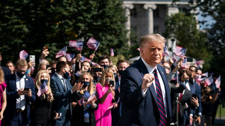 The president is seen leaving the White House as interns cheer him on in the background