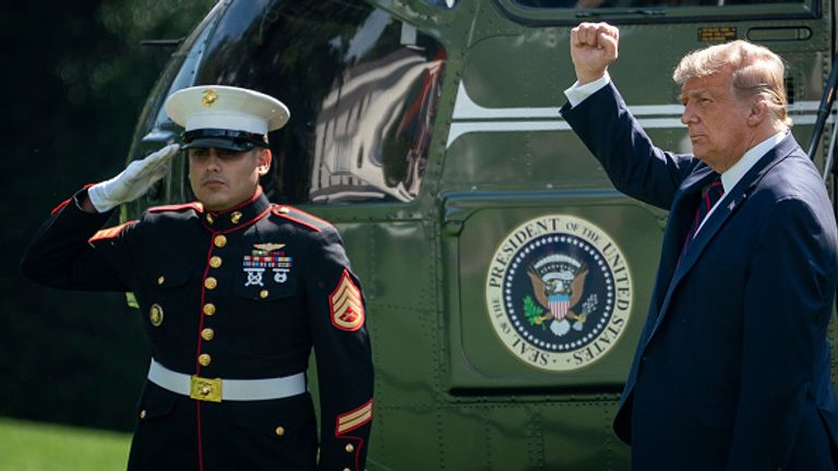 Mr Trump gestures before boarding Marine One on the south lawn of the White House to travel to the first TV debate
