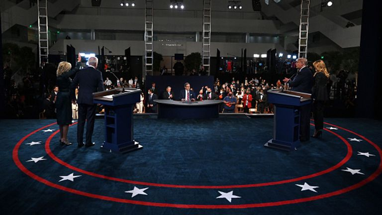 Pictured left to right: Jill Biden, Joe Biden, moderator and Fox News anchor Chris Wallace, Donald Trump and his wife Melania at the TV debate in Cleveland