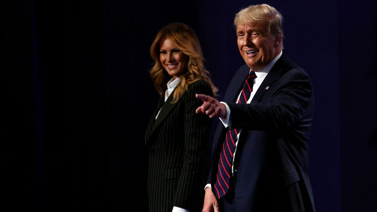 The Trumps are pictured on stage together during Tuesday's TV debate in Cleveland