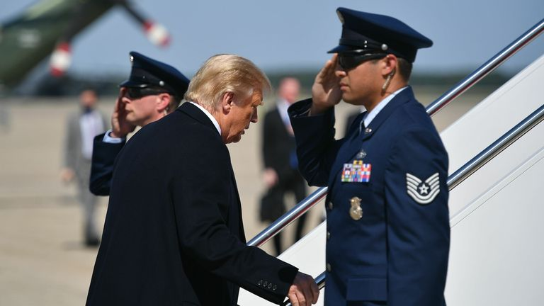 US President Donald Trump makes his way to board Air Force One before departing from Andrews Air Force Base in Maryland on October 1, 2020. - President Trump is heading to Bedminster, New Jersey for a fundraiser. (Photo by MANDEL NGAN / AFP) (Photo by MANDEL NGAN/AFP via Getty Images)