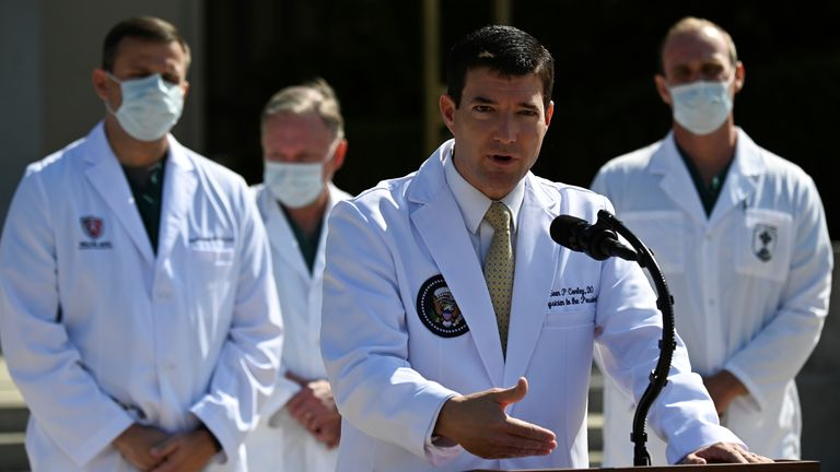 Dr Sean Conley, the White House physician, is flanked by other doctors as he updates the media about President Trump's health