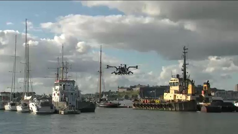A drone is pictured being tested above the harbour