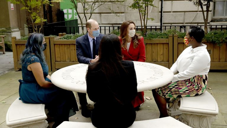 The Duke and Duchess of Cambridge meet pharmacist Joyce Duah (right) and pharmacy technicians Amelia Chowdhury (centre) and Dipal Samuel (left) during a visit to St. Bartholomew's Hospital in London, to mark the launch of the Hold Still photography project.